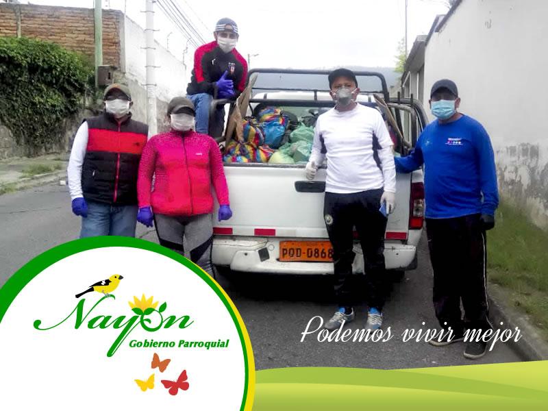 Entrega de donación en los barrios de Nayón